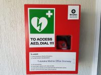 """A Defibrillator for the Marina has been installed in the doorway of the Marina Office entrance. To gain access to the life-saving unit, you must ring 111 and a code will be given over the phone to open the security lock. A very useful phone APP to download is """"AED Locations """"."""